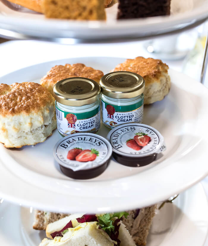 A selection of scones, sandwiches, cream and jam